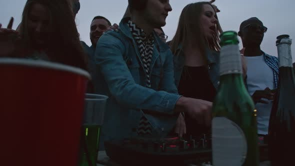 Thumbnail for DJ Mixing Music at Rooftop Party