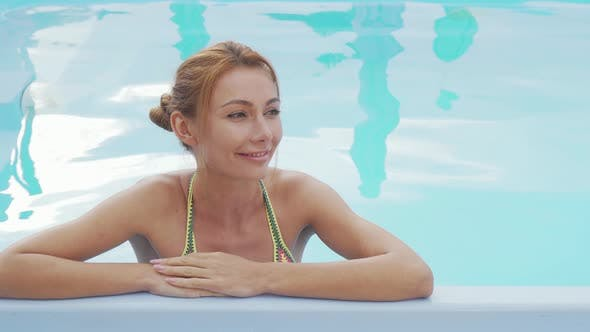 Thumbnail for Beautiful Happy Woman Smiling Relaxing in the Swimming Pool