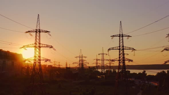 High voltage electrical lines at sunset
