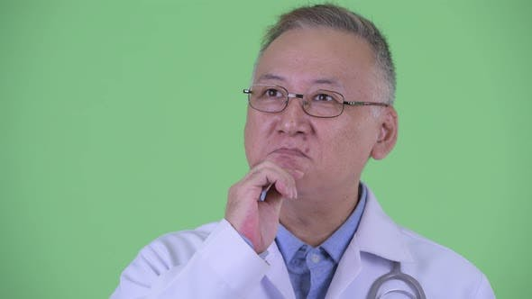 Thumbnail for Happy Mature Japanese Man Doctor Thinking