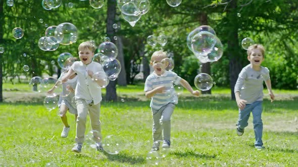Cover Image for Kids Running on Green Lawn and Popping Soap Bubbles