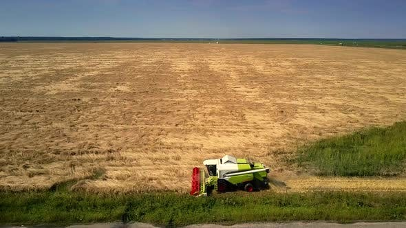 Thumbnail for Upper View Modern Harvester Works in Gold Wheat Field