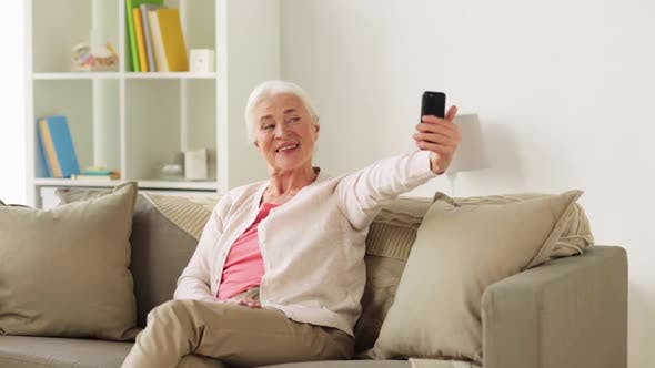 Thumbnail for Senior Woman with Smartphone Taking Selfie at Home
