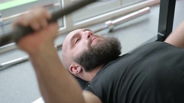 Thumbnail for Strong Heavyweight Athlete Thoroughly Doing Barbell Exercise With Strained Face