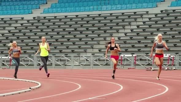 Thumbnail for Sportswomen Running along Stadium Tracks