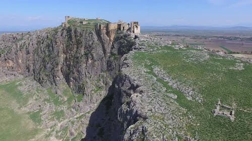 Historical Castle On The Mountain Summit With High Cliff Rocky Wall
