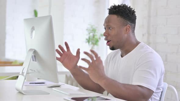 Thumbnail for Shocked Casual African Man Reacting To Failure on Desktop