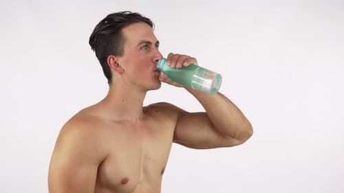 Athletic Happy Healthy Man Smiling, Drinking Water After Gym