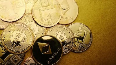 Close up of golden coins with crypto currency symbol background.