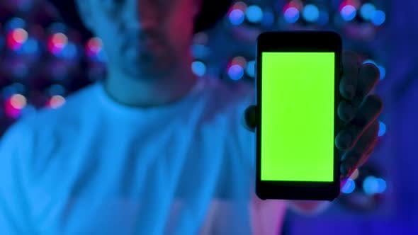 Man Using Hand Smartphone Presents Green Screen Chroma Key Vertical Display Glow