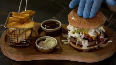 Chef Hands Making Gourmet Hamburger.
