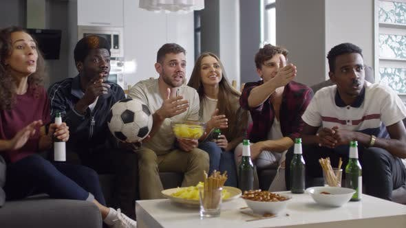 Thumbnail for Friends Watching Soccer on TV