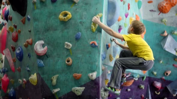 Thumbnail for Caucasian Teenager Bouldering at Climbing Gym