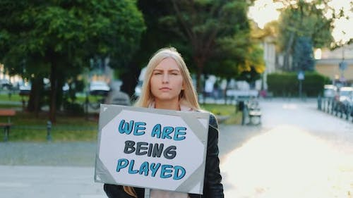 Pretty Girl Protesting Against Authorities That Playing Human Lives