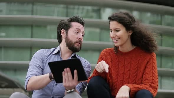 Thumbnail for Happy Couple Using Digital Tablet Outdoor