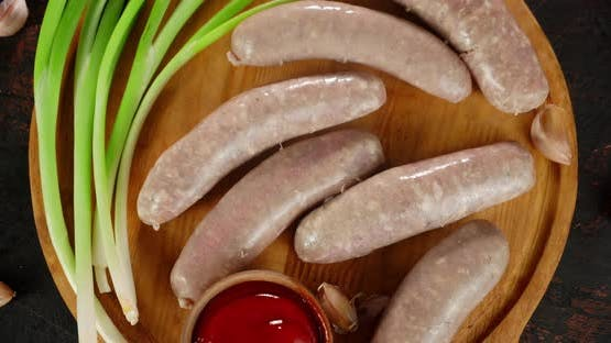 Raw Sausages with Green Onions and Tomato Sauce Rotate.