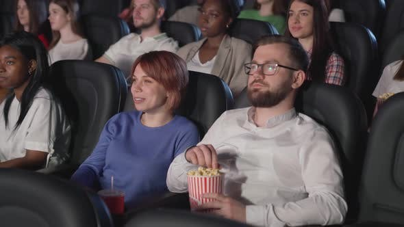 Young Couple Enjoying Movie Cinema