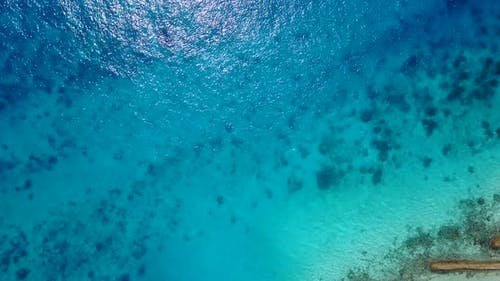 Wide drone tourism shot of a sunshine white sandy paradise beach and aqua turquoise water background