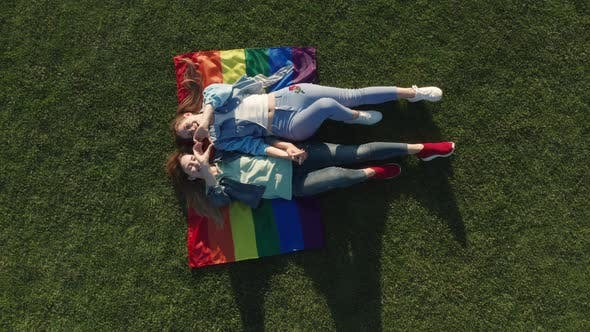 Thumbnail for Drone Shot of Lgbt Couple Lying on Rainbow Flag