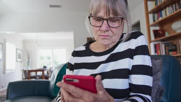 Thumbnail for Close up of Senior Caucasian woman text messaging on smartphone