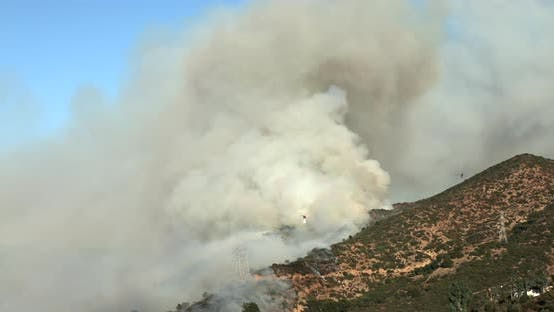 Thumbnail for Impressive Footage of Fighting a Massive Forest Fire on California Hills with the Help of Aviation