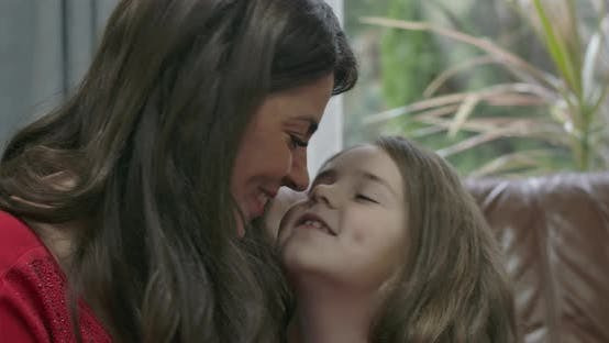 Thumbnail for Portrait of Brunette Caucasian Woman and Little Girl Rubbing Noses, Mother and Daughter Having Fun