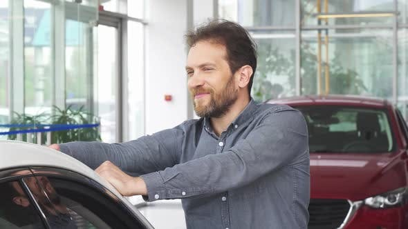 Thumbnail for Mature Happy Handsome Man Posing with His New Automobile