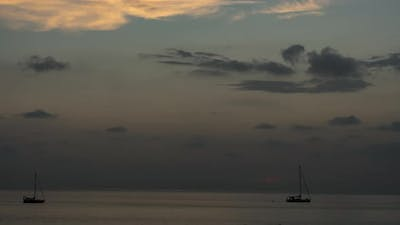 Silhouette of a Yacht on a Sunset Background