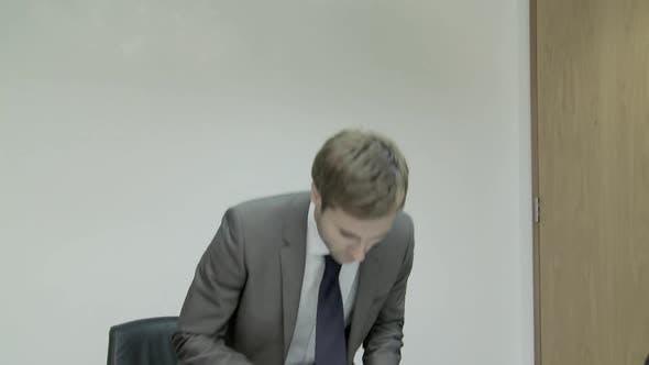 Businessman entering meeting room