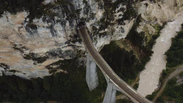 Thumbnail for Top View Aerial Shot of Famous Landwasser Viaduct Mountain Bridge and Wild River, Travel Destination
