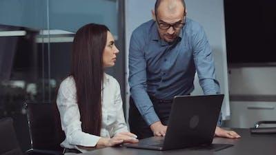 Boss Talking to Employee in Office