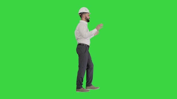 Engineer in Hardhat Walking and Explaining Something on a Green Screen, Chroma Key.