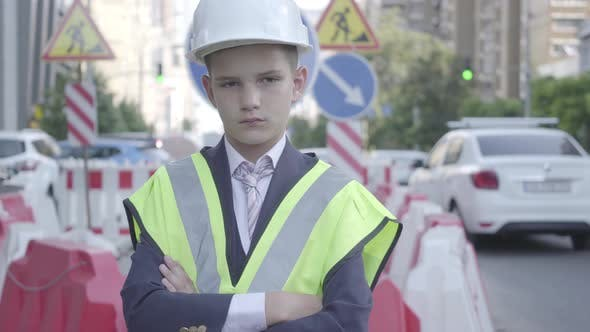 Thumbnail for Portrait Cute Little Confidient Boy Wearing Business Suit and Safety Equipment and Constructor