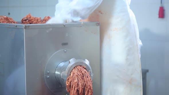 Meat Through A Grinder.