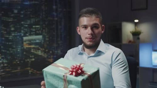 Handsome Young Man with Beard Presenting Special Present to the Camera