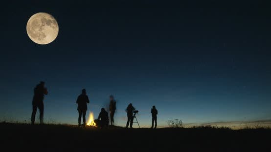Cover Image for Adult Friends Stargazing Together at Night