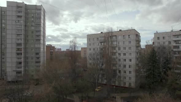 Aerial view of multistorey houses and yard in Moscow