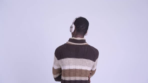 Cover Image for Rear View of Young African Man Pointing Finger Ready for Winter