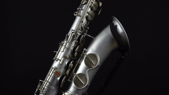 Thumbnail for Wind Instrument Saxophone On A Black Background