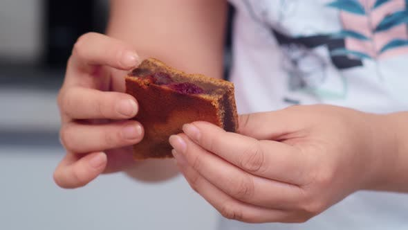 Confectioner Shows Brownie with Cherries