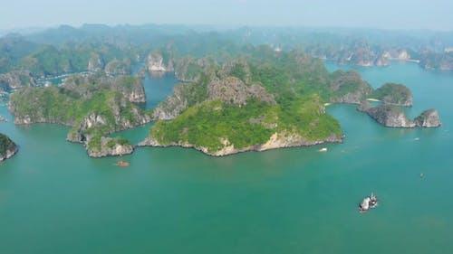 Aerial: unique flying over Ha Long Bay Lan Ha bay Cat Ba island Vietnam
