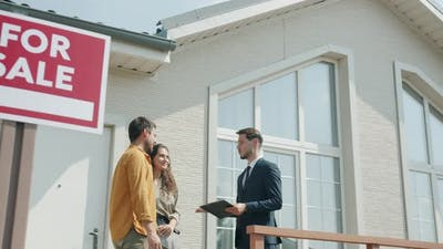 Girl and Guy Discussing Housing Deal with Real Estate Agent Outdoors Near Beautiful Suburban House