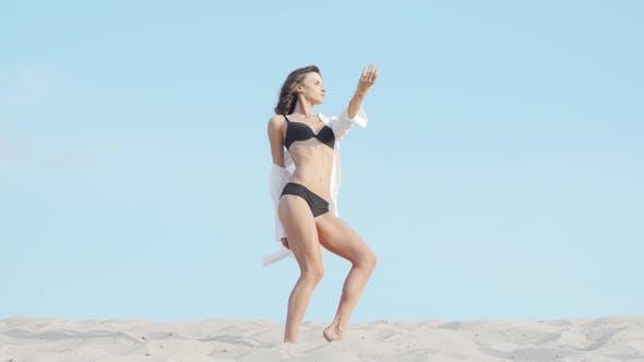 Full Length Shot of a Gorgeous Seductive Woman Dancing in Black Bikini