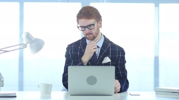 Thumbnail for Redhead Pensive Man Thinking and Working on Laptop