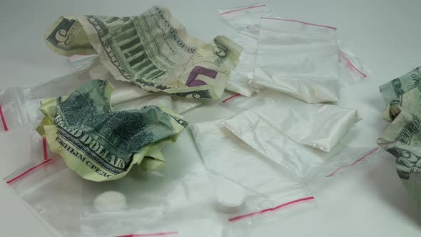 Thumbnail for Cocaine And Crumpled Money Fall On The Table