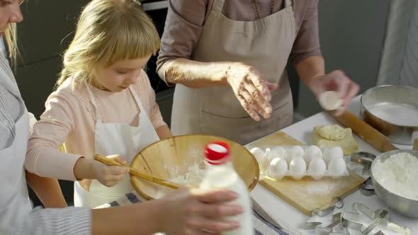 Thumbnail for Little Girl Learning how to Make Dough