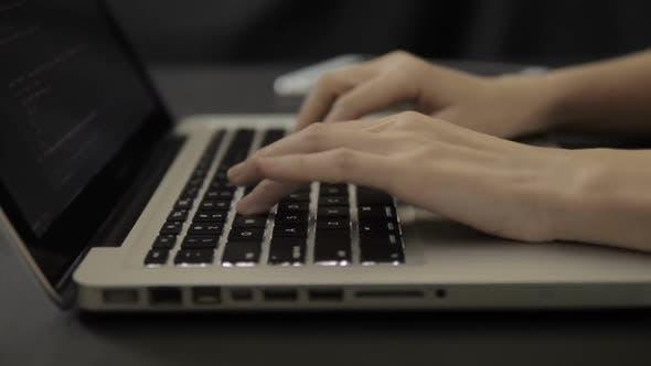 Thumbnail for Programmer Working On Laptop