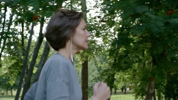 Thumbnail for Beautiful Woman Running with Headphones