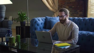 Hipster Man Freelancing at Home Office
