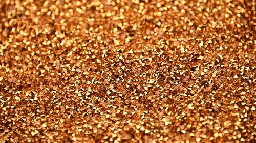 Abstract background of golden rhinestones spinning